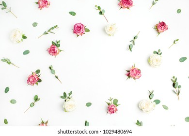 Floral frame made of red and white rose flowers and eucalyptus branches on white background. Flat lay, top view elegant mockup with copy space.
