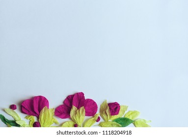 Floral frame made of tissue paper on a blue background for decoration of the inscription.