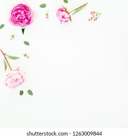 Floral frame of pink peonies flowers, hypericum and eucalyptus leaves on white background. Flat lay, top view