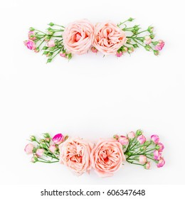 Floral frame with pink rose, leaves and buds isolated on white background. Flat lay, top view. Frame background