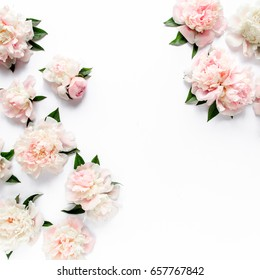 Floral frame wreath made of pink and beige peonies flower buds, eucalyptus branches and leaves isolated on white wooden background. Flat lay, top view. Frame of flowers.