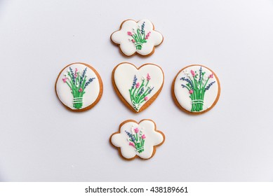 Floral icing decorated cookies. Flowers and lavender. Free space. Summer wedding gift.