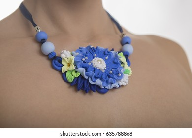 Floral Jewelery. Romantic style: Polymer clay jewelery: beautiful woman with a big floral Necklace. Vintage handmade fashion accessories. Jewel Flower. Beauty and fashion accessories