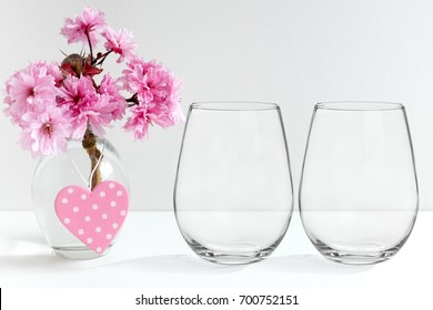 Floral mock-up of two stemless wine glasses, perfect for businesses who sell decals, vinyl stickers, just overlay your design