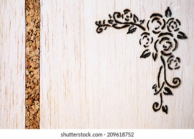 A a floral model made with pyrography on wood.