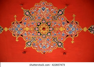 Floral motif painted on red colored ceiling at Patawon-ki-Haweli in Jaisalmer, Rajasthan, India, Asia