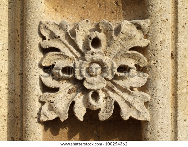 Floral ornament, carved relief decoration in stone.