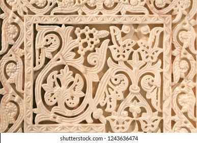 Floral paterns of 10th century ruined Moorish medieval city Medina Azahara in Andalucia region, Spain.
