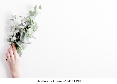 Floral pattern with green leaves on white background top view mockup