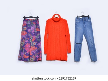 floral pattern long skirt with red sundress dress,blue jeans  on hanging