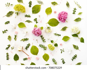 floral pattern made of blooming flowers and leaves. creative arrangement for holiday greeting card. flat lay, top view