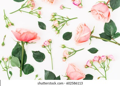 Floral pattern with pink flowers, branches and leaves on white background. Flat lay, Top view. Roses background.