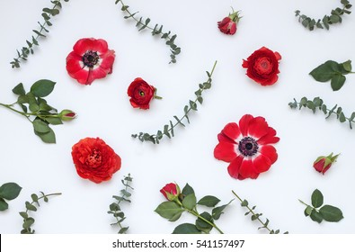 Floral pattern with red flowers on white  background. Top view