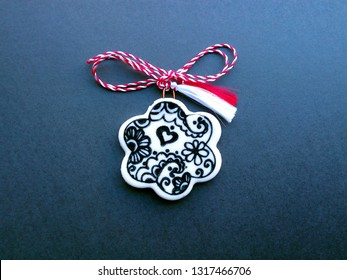 """Floral pendant with red and white string. Known as """"martisor"""" it is a Romanian symbol of spring offered to loved ones as a talisman of good luck, health, friendship, love and respect."""