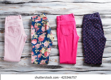Floral and pink folded pants. Woman's trousers of bright color. Low price and free delivery. Colors and patterns.