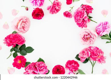 Floral round frame of pink roses and anemone, peony flowers on white background. Flat lay, Top view. Pastel flowers texture.