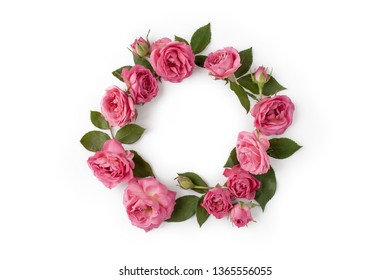 Floral round wreath. Flowers composition made of roses and leaves isolated with shadows on white background. Top view.