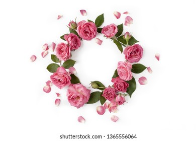 Floral round wreath. Flowers composition made of roses, leaves and petals isolated with shadows on white background. Top view.