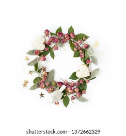 Floral round wreath. Flowers composition made of dry roses and romantic decorations isolated with shadows on white background. Top view.