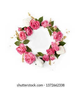 Floral round wreath. Flowers composition made of roses and romantic decorations isolated with shadows on white background. Top view.