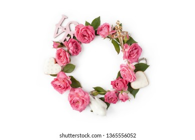 Floral round wreath. Flowers creative arrangement made of roses, leaves, hearts, love words isolated with shadows on white background. Top view.