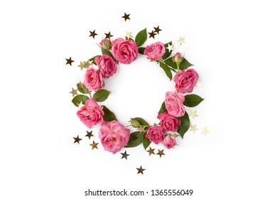 Floral round wreath. Flowers frame made of roses, leaves and golden stars isolated with shadows on white background. Top view.