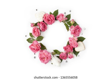 Floral round wreath. Flowers frame made of roses, hearts, leaves and rhinestones isolated on white background. Top view.