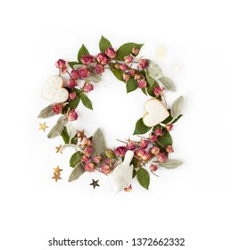 Floral round wreath. Flowers frame made of dry roses and romantic decorations isolated with shadows on white background. Top view.