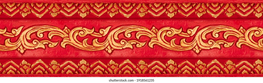 Floral seamless Asian style ornaments painted in gold and red. Golden seamless wood carving ornaments red background. Seamless vintage pattern ornament texture - Shutterstock ID 1918561235