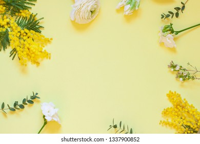 Floral spring frame with mimosas on the white background. Top view. Copy space