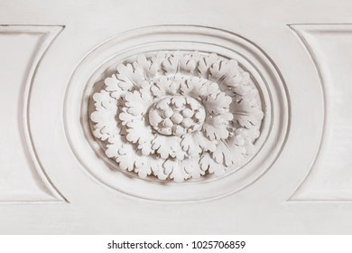 Floral stucco on a white stone wall, background, texture