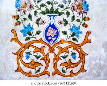 Floral and swirl ornamental design on white background.