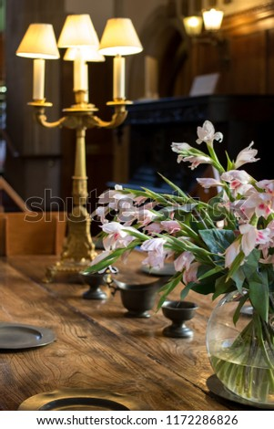 Floral Table Decoration On Oak Table Stock Photo (Edit Now
