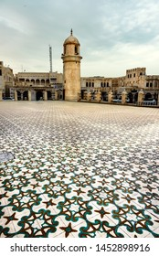 Floral tiled courtyard of a mosque in Doha Qatar
