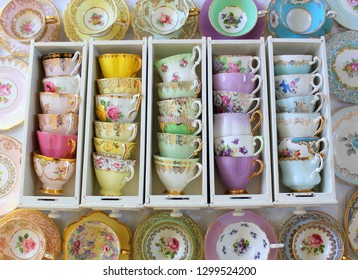 Floral Vintage Tea Cups in Rows in Antique Drawers
