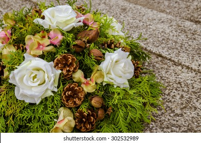 floral wreath decoration lying on the grave