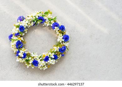 Floral wreath on concrete background