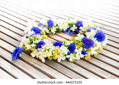 Floral wreath on wooden table