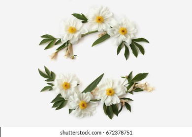Floral wreath with white peonies, buds and needle-shaped leaves of iris isolated on white background. Flat lay, top view. Mother`s day concept.