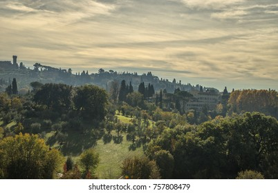 Florance farms in Toskana, Italy at sunrise with cypresses trees, green field and clowdy sky