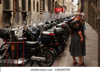 Florance / Italy - August 2007: Streets of Florence with motorcycles