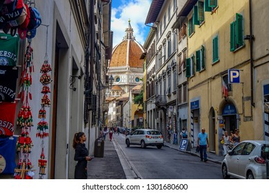 Florance, Tuscany / Italy - 09.15.2017: Cityscape streets of Florence with the Florance duomo at the end with people