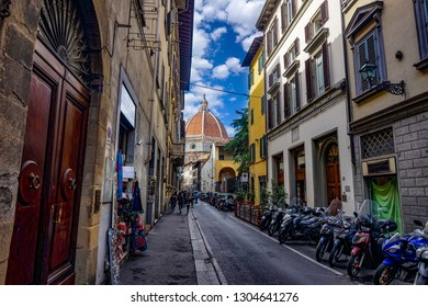 Florance, Tuscany / Italy - 09.15.2017: streets of Florence with motorcycles the Florance duomo at the end and blue sky