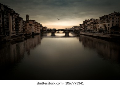 Florence Arno river under a moody sky at dusk
