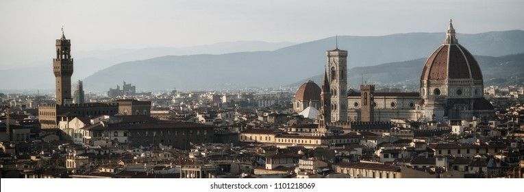 Florence Cathedral (Cattedrale di Santa Maria del Fiore) in historic center of Florence, Italy with panoramic view of the city. Florence Cathedral is the major tourist attraction of Tuscany, Italy.