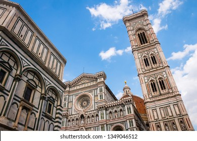 Florence Cathedral Facade next to Giotto's bell tower with Brunelleschi's Dome in the background
