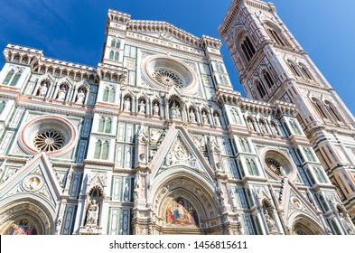 Florence Duomo beautiful marble facade, Cattedrale di Santa Maria del Fiore, Basilica of Saint Mary of the Flower Cathedral on Piazza del Duomo square in sunny day with clear blue sky, Tuscany, Italy