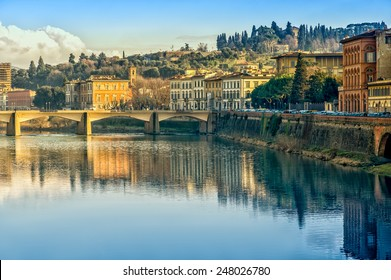 Florence or Firenze city view on Arno river, evening landscape with reflection. Tuscany, Italy.