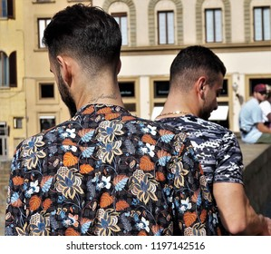 Florence, Firenze / Italy - September 21 2018: In the centre of Firenze is easy to focus on the beauty of art and buildings. But in this case I captures two guys from their shoulders. Patterns match!