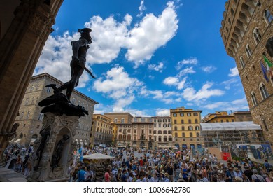 FLORENCE (FIRENZE), JULY 28, 2017 - View of a crowded Piazza della Signoria and  Benvenuto Cellini's statue of Perseus holding the head of Medusa in Florence, Florence (Firenze), Tuscany, Italy.